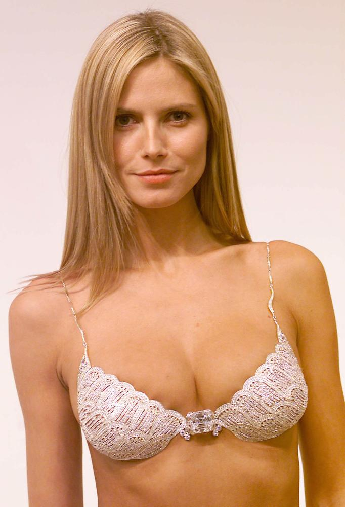 This might be the million dollar bra... but OUCH! Side, front and under spillage, not to mention a serious case of cup pinch... her boobies, I feel really bad for them.